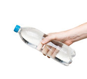 Bottle of water in hand isolated on white background Stock Image