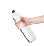 Bottle of water in hand isolated on white background Royalty Free Stock Photography