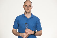 Bottle of water in hand royalty free stock photography