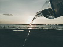 Bottle of water. Jet of water Stock Images