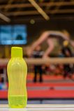Bottle of water for little gymnast girl Stock Image