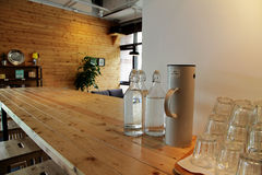 Bottle of water on long table in coffee shop Stock Photos