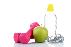Bottle with water and measuring tape Royalty Free Stock Image