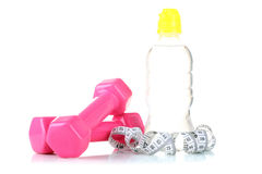 Bottle with water and measuring tape Royalty Free Stock Photos
