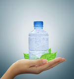 Bottle water mineral in hand Royalty Free Stock Images
