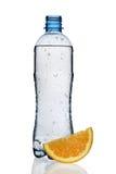 Bottle of water with orange slice. Bottle of water with orange slice, isolated on white background stock photos