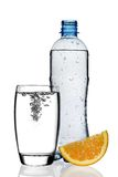 Bottle of water with orange slice and glass. Isolated on white background stock images