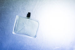 Cologne bottle. A cologne bottle on a blue and white background royalty free stock images
