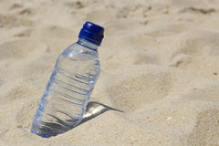 Bottle of water on the sand Stock Photos