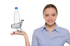 Bottle of water in shopping trolley on the palm Royalty Free Stock Photography