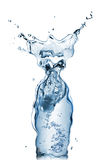 Bottle from water and splash Stock Photography