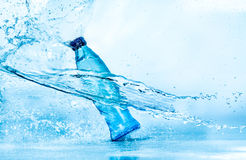 Bottle of water splash Stock Images