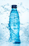 Bottle of water splash Stock Photography