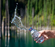 Bottle of water with splashes Royalty Free Stock Photo