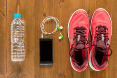 Bottle of water, telephone and running shoes for sports Royalty Free Stock Photography