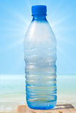 Bottle water translucent with the sun Royalty Free Stock Images