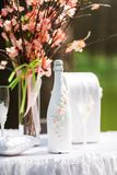 Bottle of wedding champagne decorated with flowers Stock Images