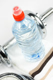 Bottle, weights and towel Stock Photo
