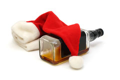 Bottle of whiskey and santa cap Royalty Free Stock Image