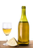 Bottle with white grape wine, piece of cheese and glass Stock Photos