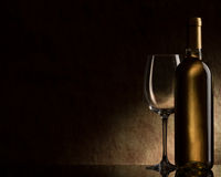 Bottle with white wine and glass stock photo