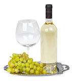Bottle of white wine, glass and grapes Stock Photo