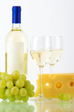 Bottle of white wine, glasses, cheese Royalty Free Stock Photos