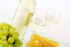 Bottle of white wine, glasses, grape and cheese Royalty Free Stock Photo