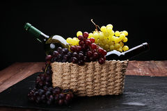 Bottle of white wine, grape and corks Stock Images
