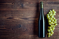 Bottle of white wine and grapes Royalty Free Stock Photos