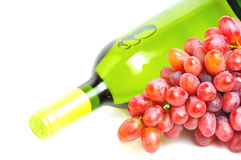 Bottle of white wine and pink grape Royalty Free Stock Photo