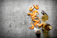 Bottle of white wine with shrimp. On the stone table Stock Photography