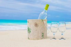 Bottle of white wine and two glasses on the exotic Stock Photos