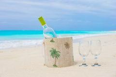 Bottle of white wine and two glasses on the exotic Stock Photo