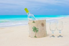 Bottle of white wine and two glasses on the exotic Stock Images