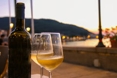 Bottle of white wine and two glasses on the restaurant table Royalty Free Stock Photos