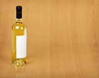 Bottle of white wine on wooden table Stock Photo