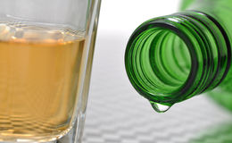 Bottle and wine. Green bottle and a glass of wine Stock Images