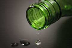 Bottle and wine. Green bottle; glass of wine Royalty Free Stock Photos