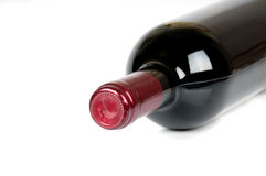 Bottle of wine. A bottle of red wine on a white background Royalty Free Stock Images