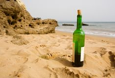 Bottle of wine. On the beach Royalty Free Stock Photo