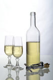 Bottle of wine. With a corkscrew and two cups Royalty Free Stock Photography