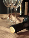 Bottle of wine. Laying behind the wine glasses Stock Photography