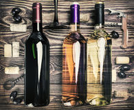 Bottle of wine and accessories on a wooden table Stock Image