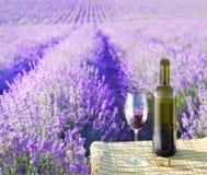 Bottle of wine. Bottle of wine against lavender landscape Royalty Free Stock Photography