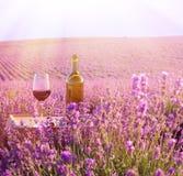 Bottle of wine. Bottle of wine against lavender landscape Stock Photography