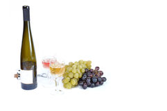 Bottle of wine with aperitive, glasses of wine. And grapes Royalty Free Stock Photo