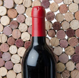 Bottle of wine on a background of corks Stock Image