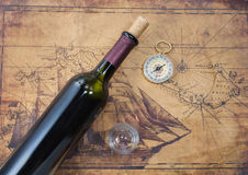 Bottle of wine  on the background. Of old maps Stock Image