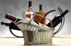 Bottle of wine in a basket stock image